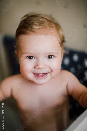 Happy cute baby boy smiling with teeth and sitting in the ...