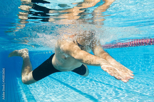 Photo  Breaststroke swimming man under water