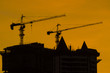 Sunset over the construction crane