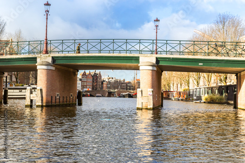 Photo  Amsterdam canals, bridges and houses