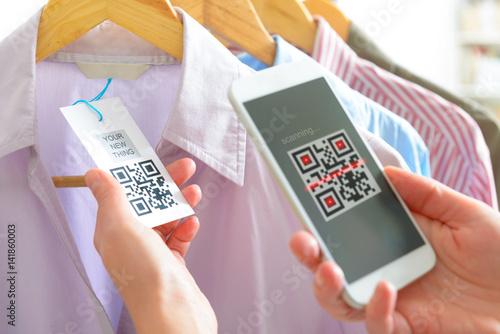 Valokuva  Woman scanning QR code