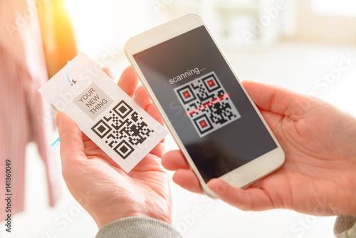 Fotografie, Obraz  Woman scanning QR code