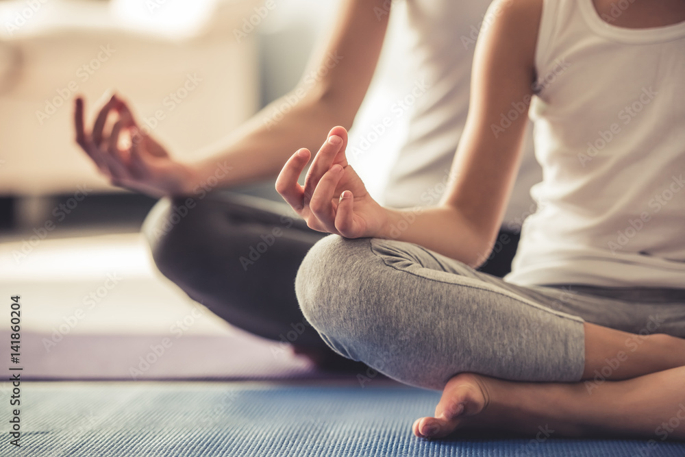 Fototapety, obrazy: Mom and daughter doing yoga