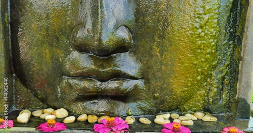 Buddha face statue with traditional asian decoration in ancient culture temple i Canvas Print