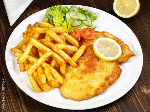 wiener schnitzel mit pommes frites und salat buy this stock photo and explore similar images. Black Bedroom Furniture Sets. Home Design Ideas