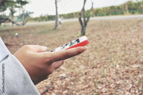 Spoed Foto op Canvas Olijfboom Woman using smart phone