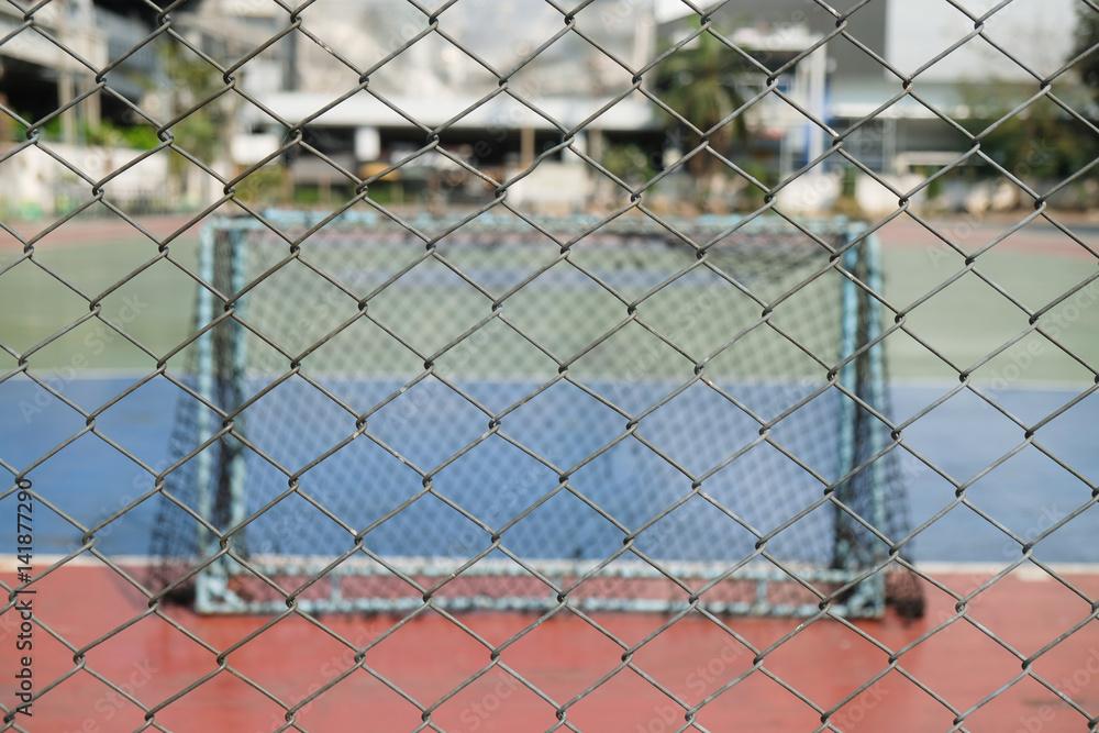 Photo & Art Print Steel mesh / View of steel mesh and futsal field ...