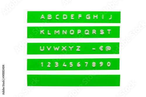embossed alphabet on green plastic tape, isolated on white Tablou Canvas