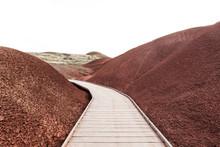 Decked Pathway Through Red Gravel Hills, Mitchell, Oregon, Usa