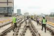 Engineer walk on track or railway on viaduct of sky train for inspect trackwork