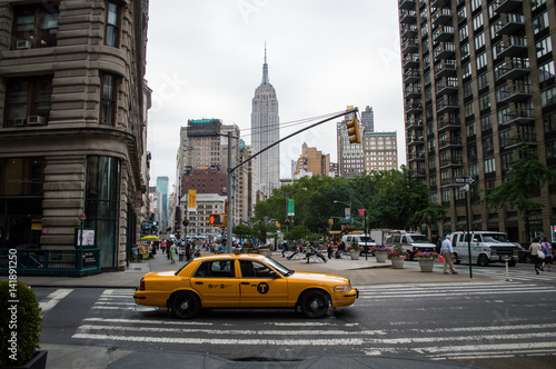 Cab and Empire State Building under a Grey Sky in Manhattan, New York, USA