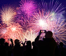 Crowd Watching And Recording Fireworks On Cellphones