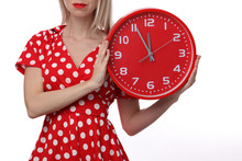 Attractive Woman Wearing Vintage Dress Holding Holding A Clock. It's Time Concept