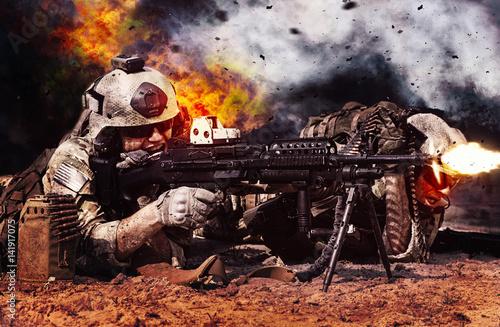 Two crewman of machine gun crew firing in the desert Fototapeta