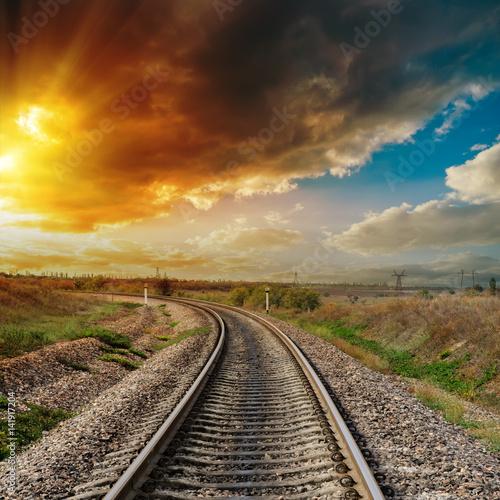 good orange sunset over railroad
