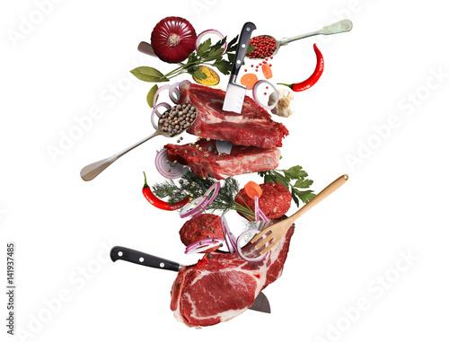 Staande foto Vlees Meat and beef meatballs with vegetables and utensils