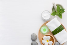 Spa Concept With Salt, Mint, Lotion, Towel, Candle, Stone And Flower On White Background