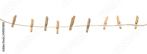 Fototapeta  Old wooden clothespins on a rope isolated on  background
