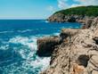 Rocks on the sea in Montenegro. Rocky coast. Wild beach. Dangerous coast.
