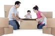 Happy family with cardboard on studio