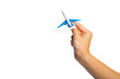 hand holding airplane toy model isolated on white background