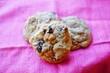 Leinwanddruck Bild - Homemade raisin cookies on a pink background