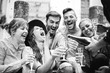 canvas print picture - Group of friends having a party in the city drinking champagne