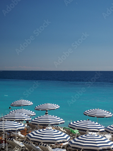 Spoed Foto op Canvas Nice umbrellas beach in Nice, France The French Riviera