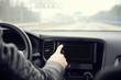 Man switching on car radio.