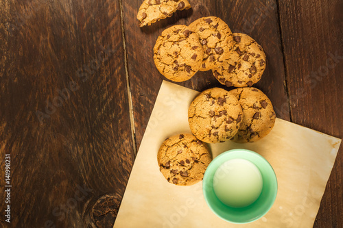 Garden Poster Cookies Chocolate chips cookies on baking paper, with milk glass