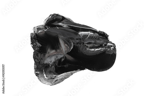 Bitumen, a piece of black resin on a white background Canvas Print
