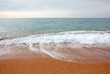 Sandy beach and sea waves as a place for rest and travel