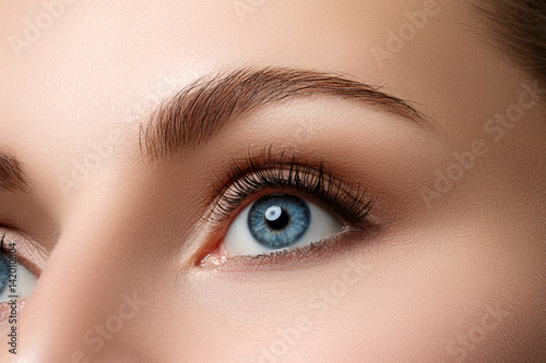 Photographie  Close up view of beautiful blue female eye