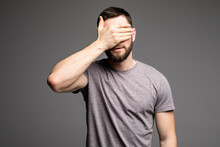 Man Covers His Face