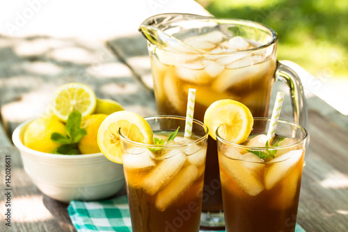 Iced Tea With Lemon and Mint On Picnic Table Canvas Print