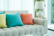 Colorful Pillows On Sofa In Li...