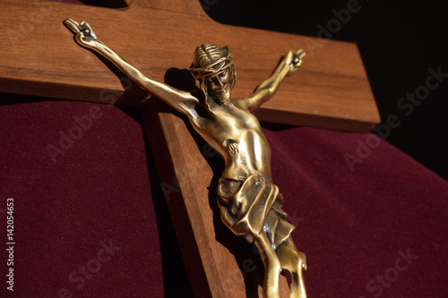 Fotografie, Obraz  Crucifix Bronze Christ on Wooden Cross