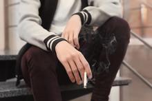 Teenage Boy Holding Cigarette, Closeup