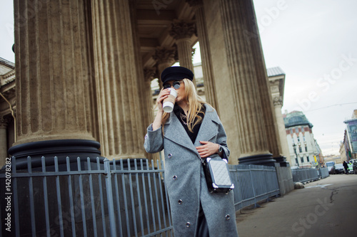 Young, hip and attractive blonde walking around the city