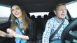 Funny couple singing, dancing, taking selfie, suddenly slowing to avoid accident