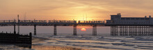 Panorama With Sun Rising Behind The Pier At Worthing
