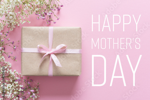Mother's day card, pink background with white flowers and a present