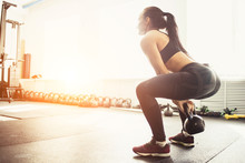 Athletic Woman Exercising With...
