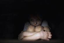 Frightened Child In The Dark