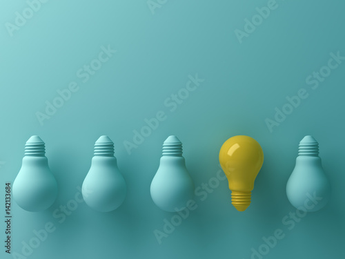 Think different concept , One yellow light bulb standing out from the unlit green incandescent lightbulbs with reflection and shadow , leadership and different creative idea concept Fototapeta