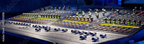 Fotografie, Obraz  sound studio adjusting record equipment.