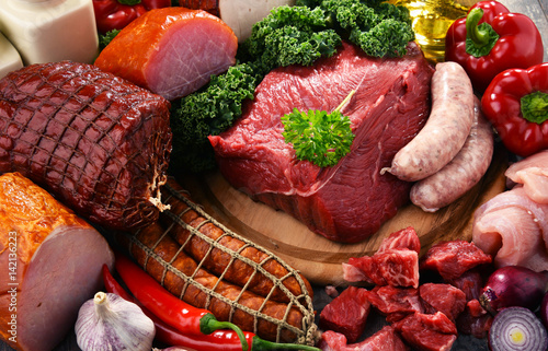 Fototapeta Variety of meat products including ham and sausages obraz