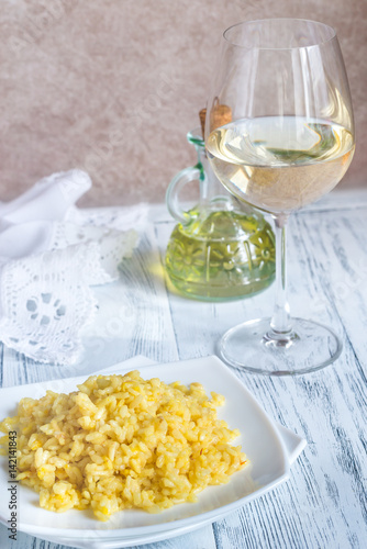 Portion of risotto with glass of white wine Wallpaper Mural
