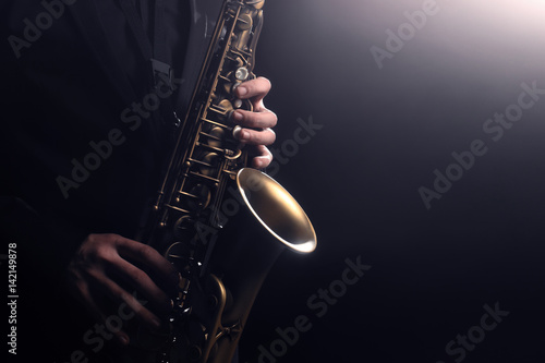 Foto auf Leinwand Musik Saxophone player Saxophonist playing jazz music instrument