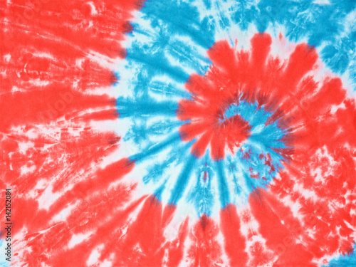 Close Up Shot Of Red White And Light Blue Color Tie Dye Fabric Texture Background